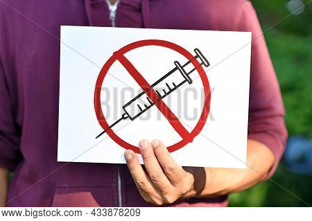 Anti Vaccine Demonstration Sign With Syringe Drawing In Red Crossed Out Circle