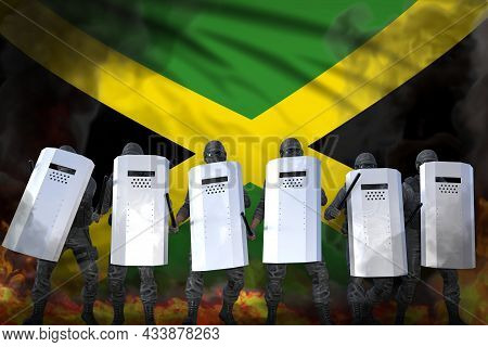 Jamaica Protest Fighting Concept, Police Squad In Heavy Smoke And Fire Protecting Order Against Demo