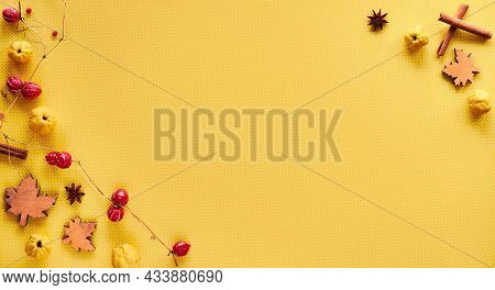 Autumn Decorations On Yellow Paper With Copy-space. Quince Fruits, Natural Garland, Wooden Deco Leav