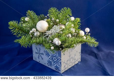 Blue Box With Pine Cones And White Balls Christmas Tree. New Year Christmas Decorations With Pine Co