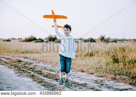 A Boy Plays In An Airplane In Nature In The Summer . The Boy Dreams Of The Future. Buying Real Estat