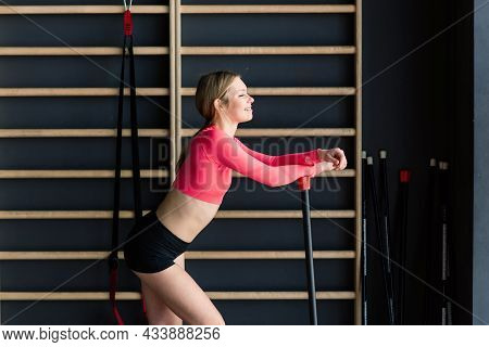 Beautiful Muscular Fit Woman Exercising, Building Muscles In Gym
