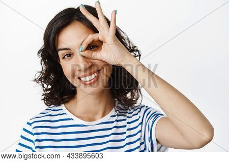 Close Up Portrait Of Happy Young Woman, Smiling White Teeth And Showing Okay Ok Gesture, Approve And