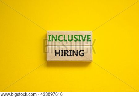 Inclusive Hiring Symbol. Wooden Blocks With Words Inclusive Hiring On Beautiful Yellow Background. B