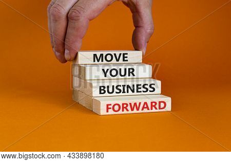Move Your Business Forward Symbol. Concept Words 'move Your Business Forward' On Wooden Blocks On A