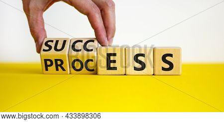 Success Business Process Symbol. Businessman Turns Wooden Cubes With Words 'success Process'. Beauti