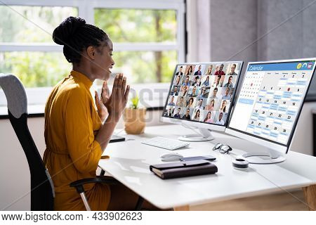 Virtual Conference Agenda On Multiple Computers In Office