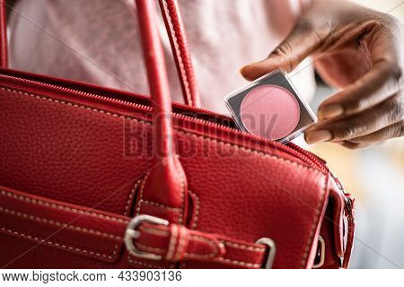 Woman Stealing Compact Makeup Powder In Retail Store. Shoplifting Theft Crime