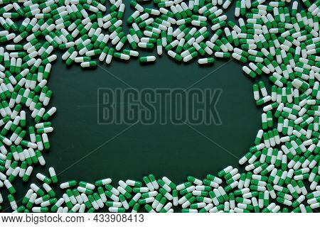 Pills Frame.homeopathic Herbal Green Capsules On Green Background. Medicine And Homeopathy . Alterna