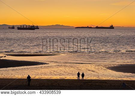 English Bay Sundown Vancouver. Freighters Anchored In English Bay. In The Background Are The Hills O