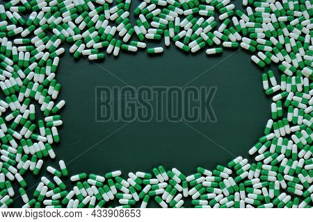 Pills Frame.homeopathic Herbal Green Capsules On Green Background. Medicine And Homeopathy . Green P