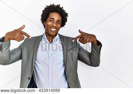 Young african american man wearing business jacket over isolated white background looking confident with smile on face, pointing oneself with fingers proud and happy.