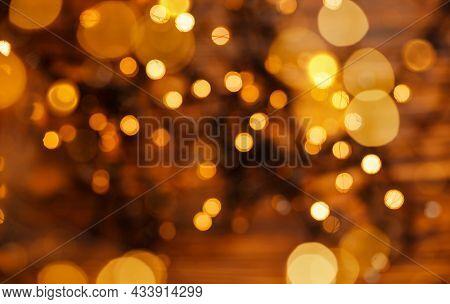 Beautiful Shiny Christmas Lights. Glowing Magic Bokeh. Defocused Gold Lights. Abstract Holiday Backg