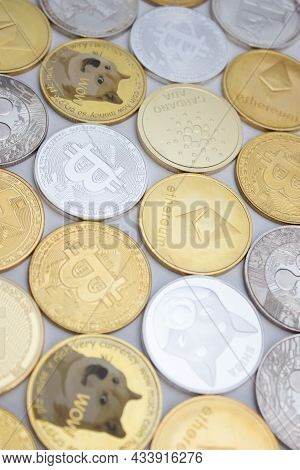 Cryptocurrency Coins (altcoins And Bitcoins) Over White Background.
