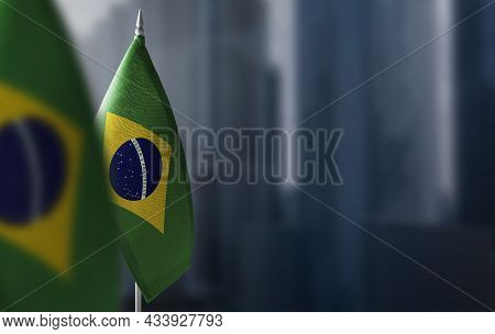 Small Flags Of Brazil On A Blurry Background Of The City