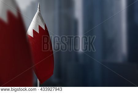 Small Flags Of Bahrain On A Blurry Background Of The City