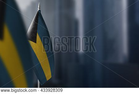 Small Flags Of Bahamas On A Blurry Background Of The City