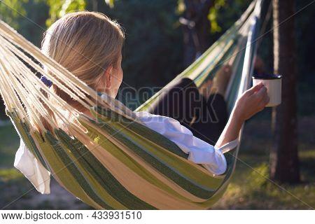 Woman relaxing in hammock in nature.Beautiful woman in hammock nature. Happy beautiful woman in nature in hammock. Beautiful woman in vacation in nature. Vacation. Hammock. nature forest.