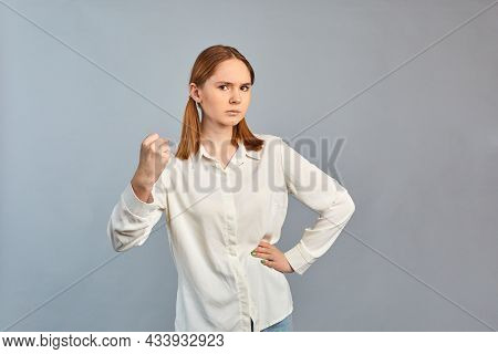 Beautiful Girl Frowning Her Face In Displeasure. Dissatisfied Shocked Young Woman Posing Isolated On