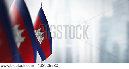 Small Flags Of Cambodia On A Blurry Background Of The City