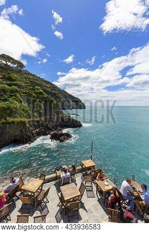 Riomaggiore, Cinque Terre - Italy, May 12, 2019: Outdoor Restaurant With Sea View In Small Village,