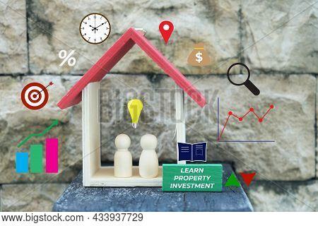Learn Property Investment Concept. House Miniature, Natural Wooden People, Investment And Valuation