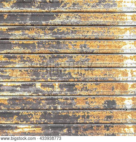Metal Shutter With Peeling Paint. Front View Of A Shutter Rusted, Deteriorated From Elements. Ideal