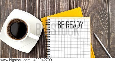 Be Ready Text On The Notebook With Coffee On The Wooden Background