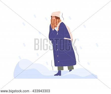 Frozen Person Walking In Cold Winter Weather With Heavy Snow And Snowflakes. Woman Wrapped In Scarf