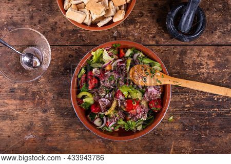 Cooking A Syrian Vegetarian Salad With Vegetables And Pita. Salad With Sumac Dressing In A Bowl, Top