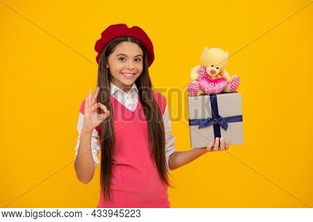 Tween And Youth. Purchase A Gift. Ok Gesture. Happy French Teen Girl Hold Present Box.