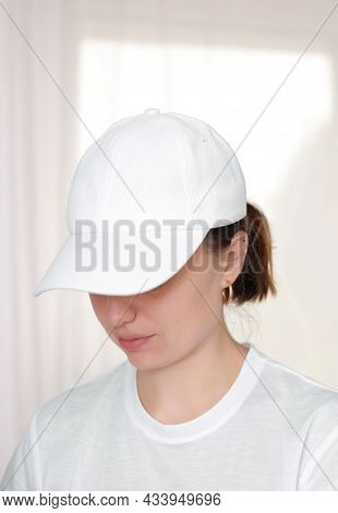 Female Model Wearing A White Baseball Cap. White Cap Mockup, Template For Picture, Text Or Logo. Gir