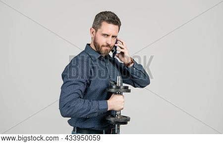 Bearded Man Businessman Training With Barbell And Speaking On Smartphone, Agile Business.