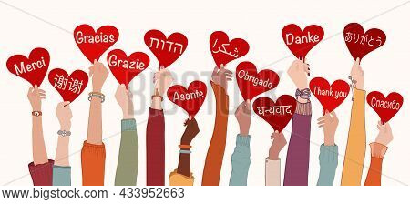 Raised Arms And Hands Of Multi-ethnic People From Different Nations And Continents Holding Heart Wit