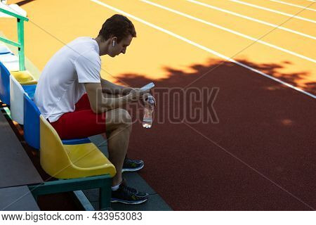 Portrait Of Young Caucasian Man, Male Athlete, Runner Isolated At Public Stadium, Sport Court Or Run