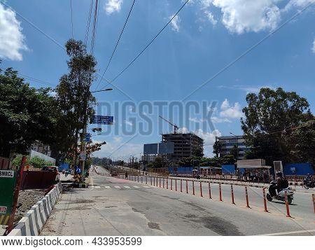 Bangalore, India- September 21st 2021; Stock Photo Of People Riding White Scooter On 4 Lane Marathah