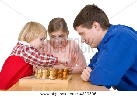 Man And Child Play Chess