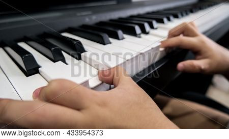 Close-up Of A Childs Hand Playing The Piano . Favorite Classical Music. Musical Instruments For Teac