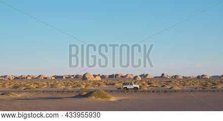 Vehicle On The Road In National Geological Park In Dunhuang, Gansu Province, China
