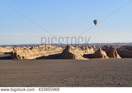 Hot Air Balloon Over Yardan Landforms In The National Geological Park Near Dunhuang, Guansu Province