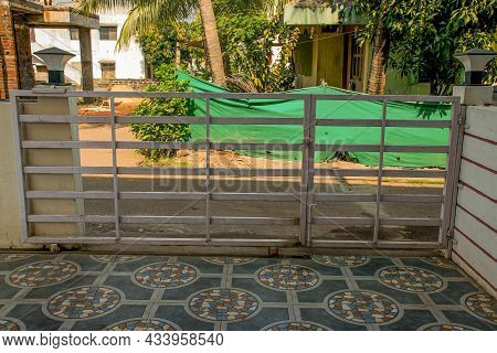 Stock Photo Of White Painted Sliding House Entrance Gate At Kolhapur, Maharashtra, India. Picture Ca