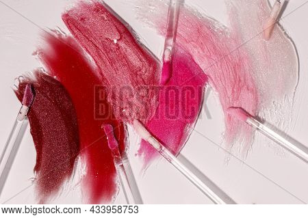 Liquid Lipstick Swatches With Sponges For Applying Isolated On White Background. Pastel Lip Gloss Ma