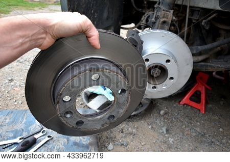 Replacement Of The Brake Disc At The Car In Domestic Conditions. The Car Repairman Removes The Worn