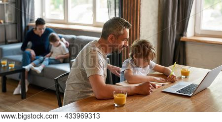 Wide Banner Shot Of Caring Caucasian Father And Small Teen Son Learn Writing Study Online At Home Wi