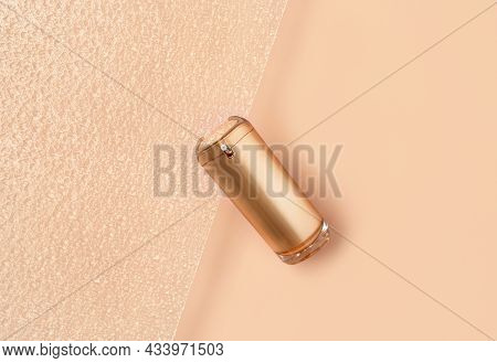Beautiful Composition Of Gold Mockup Cosmetic Bottle On Pastel And Textured Glass Background. Creati
