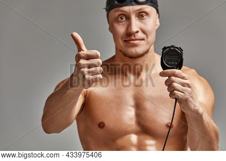 A Coach With A Stopwatch In His Hands, A Sports Swimming Coach With A Timer In His Hands, Gray Backg