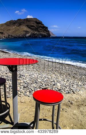 Red Table And Stool In A Bar On Las Negras Beach In Cabo De Gata-nijar Natural Park