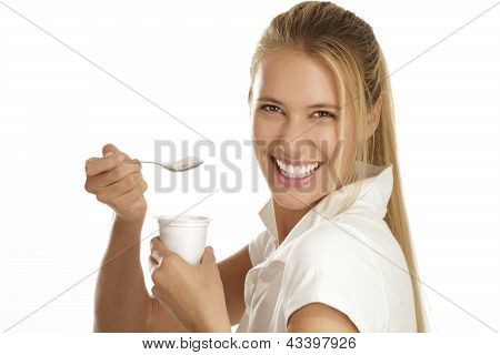 Young Woman Eating Yogurt