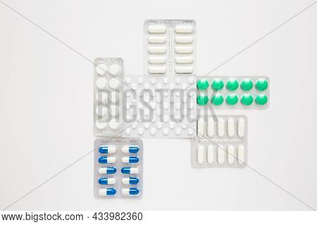 Blisters Of Pills On A White Background, Top View. Various Medications, Tablets, Medication Capsules