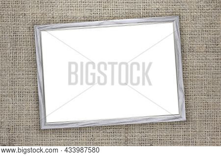 Wooden Frame With White Background Inside On Brown Burlap Background With Beautiful Brown Fabric Can